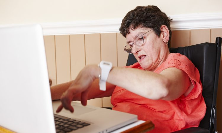 Disabled woman using computer