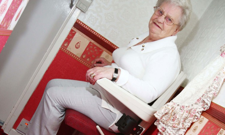 Woman using stair lift